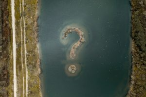 Question mark island in river